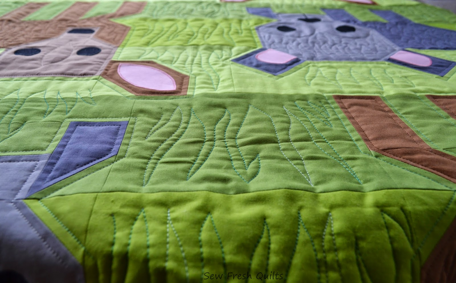http://sewfreshquilts.blogspot.ca/2014/10/wild-life-finished-top